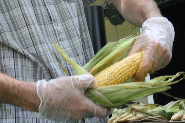 buttering_smoked_corn